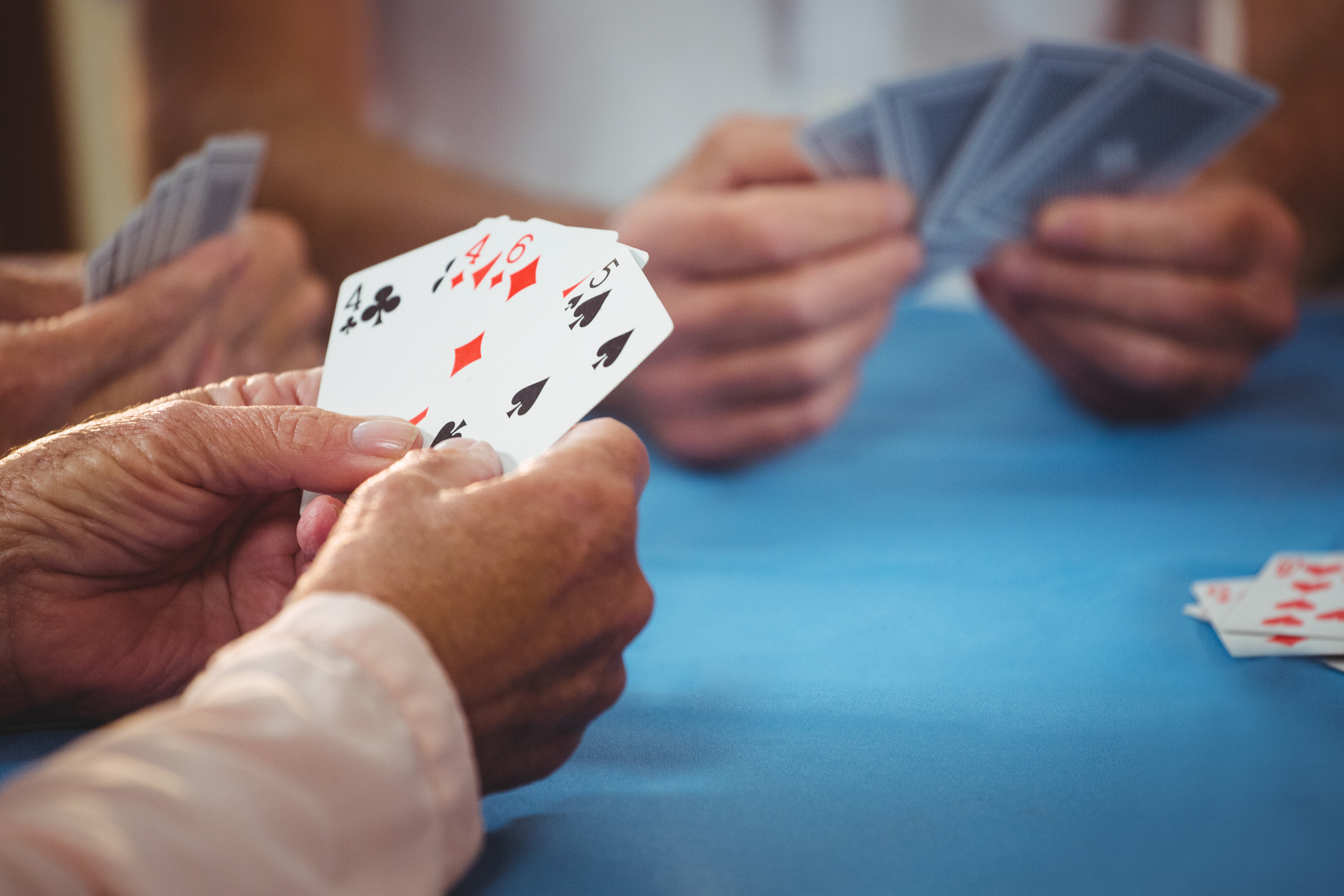 Retired people playing card in a retirement home